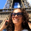 Beautiful young woman on the Eiffel tower — Stock Photo #51467467