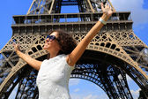 Beautiful young woman on the Eiffel tower — Stock Photo