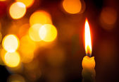 Candle on bokeh — Stock Photo