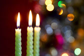 Three candle on bokeh — Stock Photo
