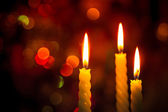 Three candle on bokeh — Stock fotografie