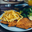 Stock Photo: Detail of viennese schnitzel on plate