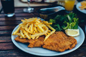 Detail of a viennese schnitzel on a plate — Stock Photo