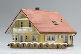 Model house with word heating costs — Stock Photo