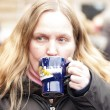 Woman drinking mulled wine — Stock Photo