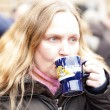 Woman drinking mulled wine — Stock Photo #25016343