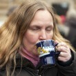 Woman drinking mulled wine — Stock Photo #25016353