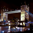 The Tower bridge in London illuminated at night — Stock Photo