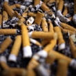 Many cigarette butts for backgrounds — Stockfoto