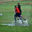 Stock Photo: Football match in rain