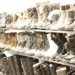 Shoes and boots in a rack - Stock Photo