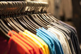 T-shirts on a clothes rack — Stock Photo