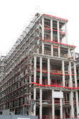 High rise construction site with a concrete structure in the process of being built as a commercial real estate structure and a business symbol of economic and financial growth and healthy economy. — Stock Photo