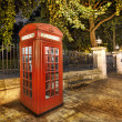Bright red London telephone box - Stock Photo