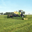 Mower mows a field — Stock Photo