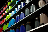Color cans in store — Stock Photo