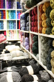 Shelves of yarn in a store — Stock Photo