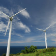 Stock Photo: Green renewable energy concept - wind generator turbines in sky