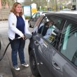 Woman fills up car — Stock Photo #25981773