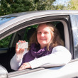 Woman and Driving license — Stock Photo