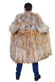 Man and fur coat — Stock Photo