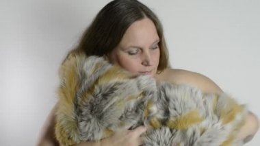 Woman and fur coat — Stock Video