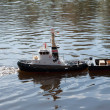Model ship is left on a lake to water — Stock Photo #41305389