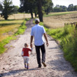 Father and Son Walking on Village Road — Stock Photo