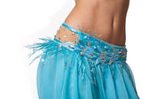 Close up shot of a belly dancer wearing a light blue costume shaking her hips. — Stock Photo
