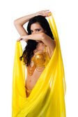 Exotic belly dancer wearing a gold costume — Stock Photo