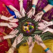 Six pairs of henna decorated female hands arranged in a circle - Stock Photo