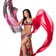 A beautiful bellydancer in a multicolor costume — Stock Photo #25591563