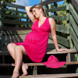 Beautiful pregnant woman sitting on the steps - Stockfoto
