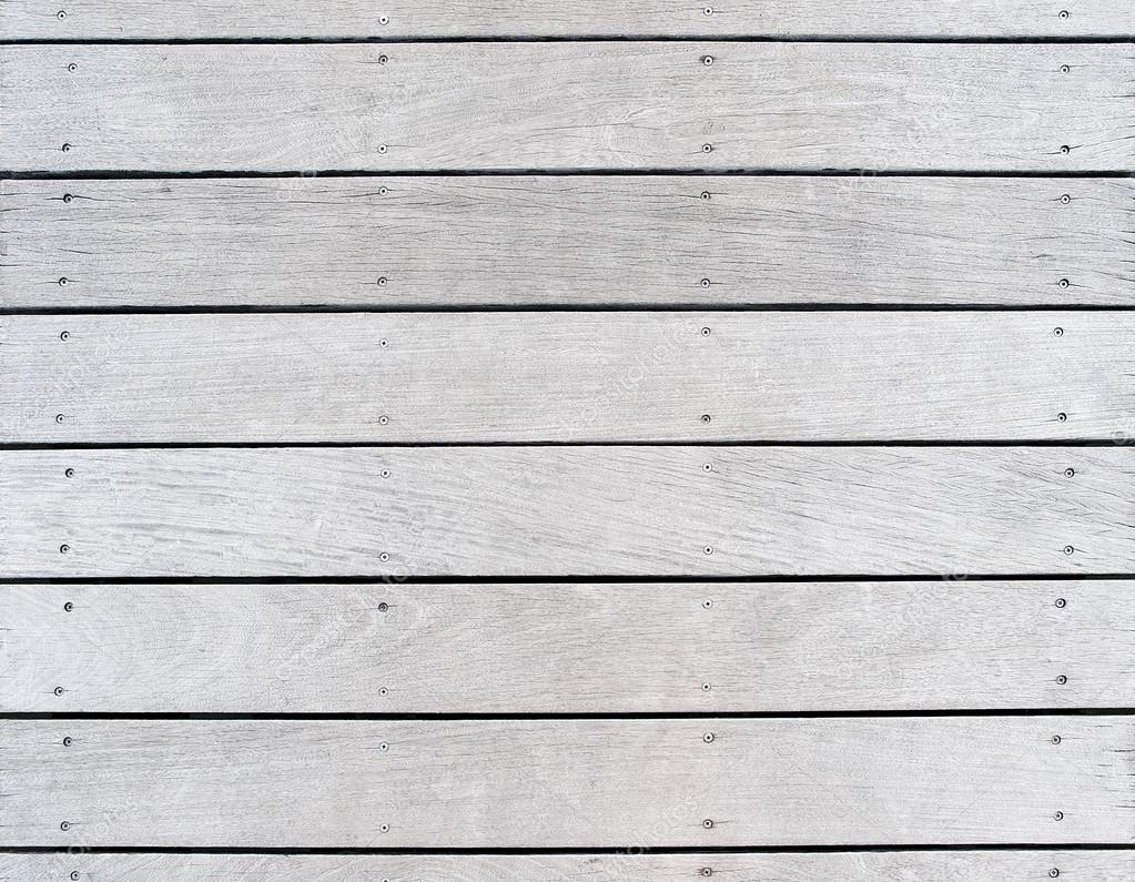 A boat dock's old weathered and faded wood decking. — Stock Photo © katrinaelena #25677659