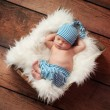 Stock Photo: Sleeping Newborn Baby Wearing Pajamas