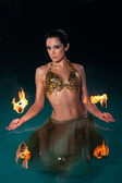 Exotic Belly Dancer with Fiery Palm Toches — Stock Photo