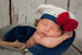 Newborn Baby in Sailor Girl Hat — Stock Photo