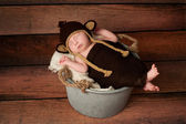 Newborn Baby in a Monkey Costume — Stock Photo
