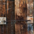 Постер, плакат: Barn Wood Doors Latched Shut