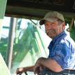 Farmer in his Tractor — Stock Photo