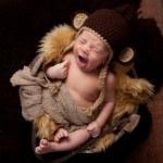 Yawning Newborn Baby Boy Wearing a Monkey Hat — Stock Photo
