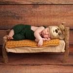 Newborn Baby Boy in a Teddy Bear Costume — Stock Photo #32528641