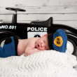 Newborn Baby Wearing a Policeman Costume — Stock Photo