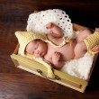 Stock Photo: Sleeping Newborn Baby in Bonnet and Leg Warmers