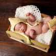 Photo: Sleeping Newborn Baby in Bonnet and Leg Warmers
