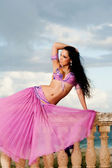 Belly Dancer in Pink Costume on Balustrade — Stock Photo