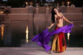 Belly Dancer in Red Costume Dances with Purple Veil — Stock Photo