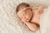 Portrait of a Newborn Girl with Lace Headband — Stock Photo