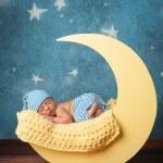 Newborn Boy Sleeping on the Moon — Stock Photo #41966881
