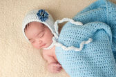 Sleeping Newborn Baby Girl Wearing a Light Blue Bonnet — Stock Photo